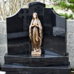 Gates Of Heaven black granite with bronze flat backed statue of Our Lady