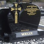 Black granite celtic cross with celtic knot gold detail