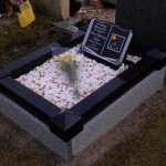 Book, black granite on stand, child memorial and surround