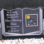 Book, black granite on stand, child memorial